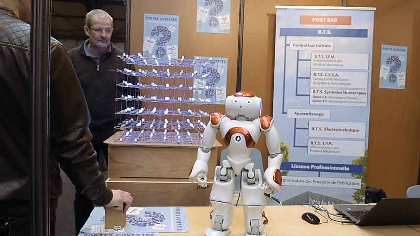 konferans : STRASBOURG, FRANCE - CIRCA 2018: Robot motion making diverse karate martial arts gestures at technical IT college stand during Education Fair
