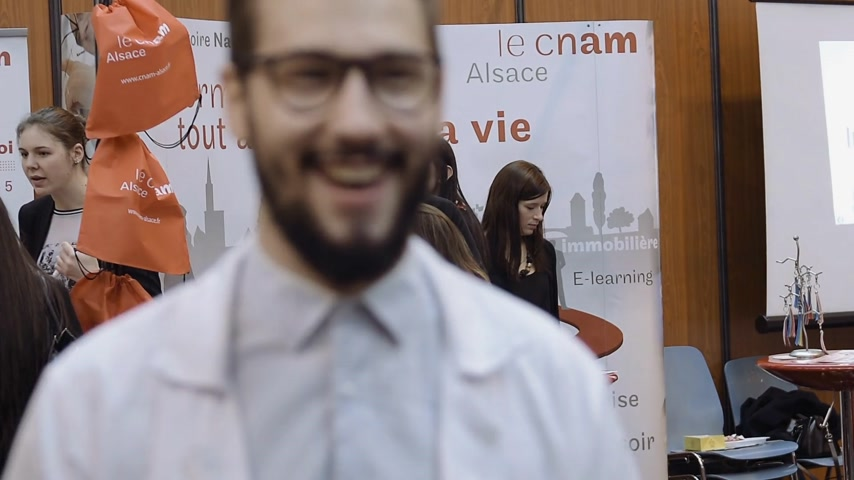 choosing path : STRASBOURG, FRANCE - CIRCA 2018: Young people attending annual Education Fair to choose career path and receive vocational counseling - CNAM Alsace stand