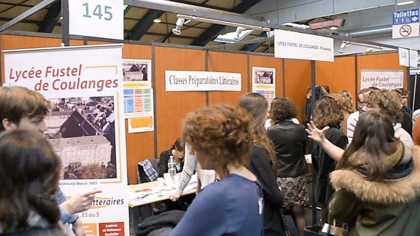 subject : STRASBOURG, FRANCE - CIRCA 2018: Children and teens of all ages attending annual Education Fair to choose career path and receive vocational counseling at lycee fustel de coulanges Stock Footage