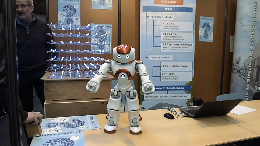 choosing path : STRASBOURG, FRANCE - CIRCA 2018: Robot motion making diverse karate gestures seen on Technology school stand at annual Education Fair to choose career path and receive vocational counseling