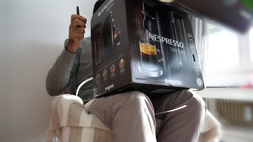 descafeinado : Paris, France - Circa 2018: Man unboxing unpacking in the living room new Nespresso Vertuo coffee capsules machines produced by Magimix - time lapse fast motion