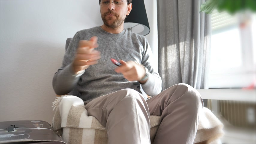 descafeinado : Paris, France - Circa 2018: Man unboxing unpacking in the living room new Nespresso Vertuo coffee capsules machines produced by Magimix with big sticker of three years warranty Vídeos