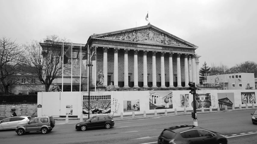 french president : PARIS, FRANCE - CIRCA 2019: Black and white still drone view winter scene of Parisian boulevard Rue Anatole France with Assemblee Generale - the national assembly building in Paris during reconstruction Stock Footage