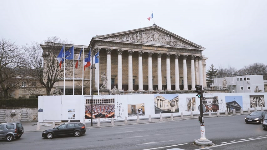 french president : PARIS, FRANCE - CIRCA 2019: Elevated still drone view winter scene of Parisian boulevard Rue Anatole France with Assemblee Generale - the national assembly building in Paris during reconstruction