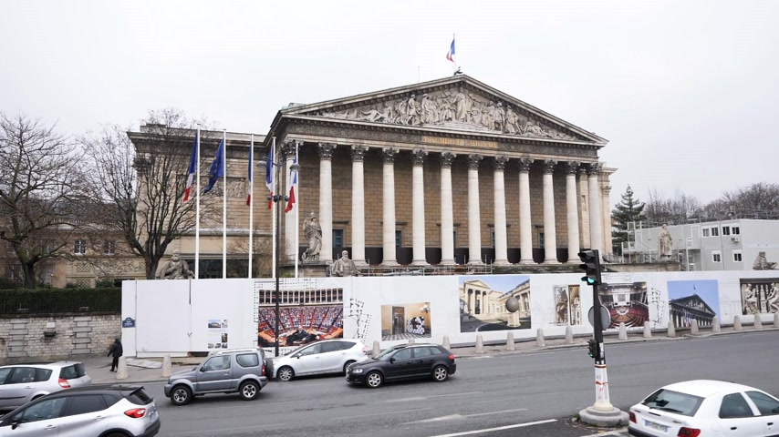 winter palace : PARIS, FRANCE - CIRCA 2019: Cinematic elevated still drone view winter scene of Parisian boulevard Rue Anatole France with Assemblee Generale - the national assembly building in Paris during reconstruction
