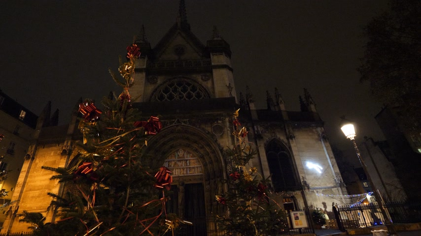 бульвар : Christmas trees decorated in front of Saint-Laurent church in Paris on Boulevard de Strasbourg near Gare de Est