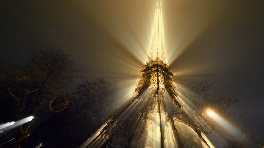 parigino : PARIS, FRANCE - JAN 2019: Unique beam CGI radiating light illuminated majestic Eiffel Tower down to top view in Paris - the most visited monument in France in 4K UHD quality Filmati Stock