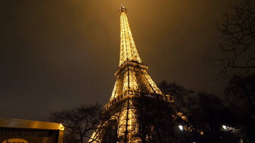 ave : PARIS, FRANCE - JAN 2019: POV from below night twilight illuminated majestic Eiffel Tower down to top - majestic Paris Stock Footage