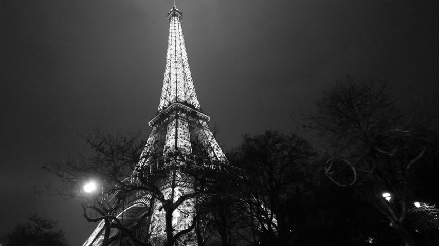 eiffel : PARIS, FRANCE - JAN 2019: Black and white night twilight illuminated majestic Eiffel Tower down to top view in Paris - the most visited monument in France being lit sightseeing discovering the French capital Stock Footage