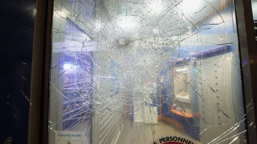 riot : Bank branch entrance with shattered destroyed bulletproof glass at the entrance of ATM automatic teller machines