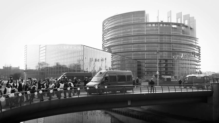 water cannon : STRASBOURG, FRANCE - FEB 02, 2018: Police forces securing European Parliament building during protest of Gilets Jaunes Yellow Vest manifestation anti-government demonstrations - black and white