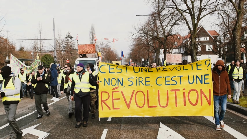 sobota : STRASBOURG, FRANCE - FEB 02, 2018: This is a rebellion, no sir, this is a revolution placard held by Gilets Jaunes Yellow Vest manifestation on the 12 Saturday of anti-government demonstrations