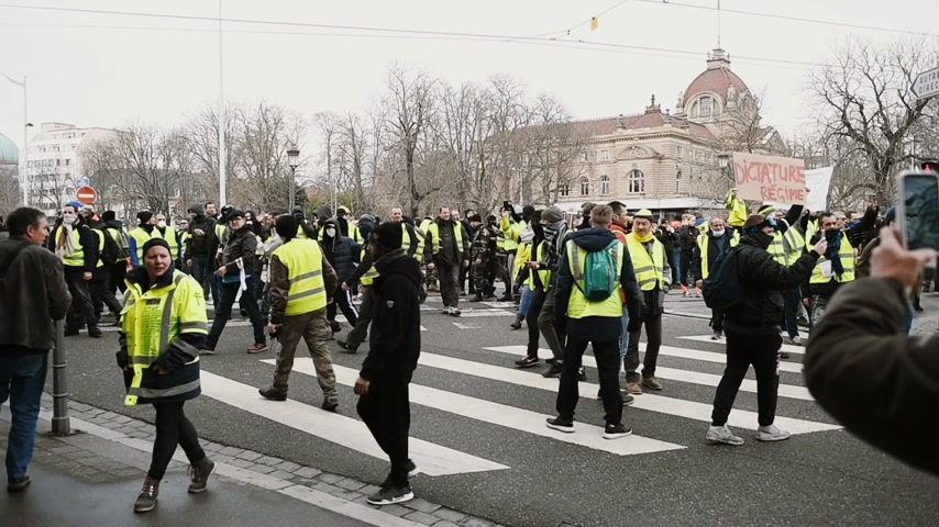austerity : STRASBOURG, FRANCE - FEB 02, 2018: Gilets Jaunes Yellow Vest manifestation on the 12 Saturday of anti-government demonstrations in front of armed police officers