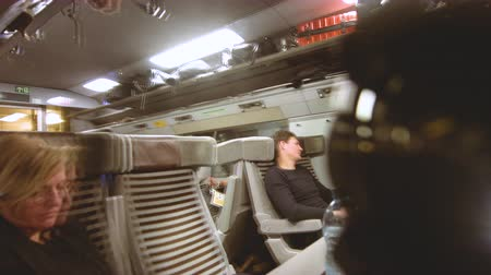 arriving : UNITED KINGDOM - CIRCA 2019: Passengers inside Eurotunnel fast Eurostar train commuting to London from Paris speed of light
