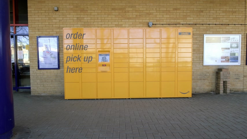 locker : OXFORD, UNITED KINGDOM - CIRCA 2017: Front view of new  Amazon locker orange delivery package locker at Oxford Train Station - Amazon Locker self-service parcel delivery service offered by online retailer Amazon.com.-