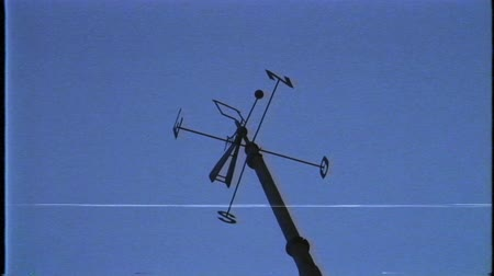 západ : Cardinal direction pointer sign against clear blue sky in Lisbon, Portugal - North, South, East, West and their initials N, E, S, and O cut from metal cinematic VHS old film tape