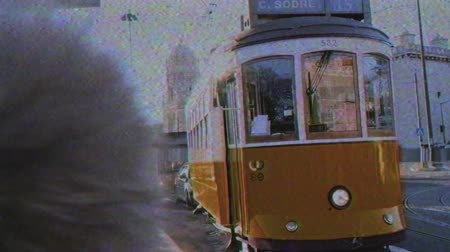 comercio : LISBON, PORTUGAL - CIRCA 2019: Male tourist using iPhone smartphone to take photo of Remodelado tram with Mosteiro dos Jeronimos in the background in Praca do Imperio VHS vintage tape