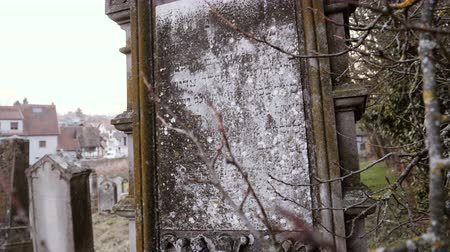 надгробная плита : QUATZENHEIM, FRANCE - FEB 20, 2019: Close-up detail of vandalized grave with nazi symbols in yellow spray-painted on the damaged graves - Jewish cemetery in Quatzenheim near Strasbourg Стоковые видеозаписи