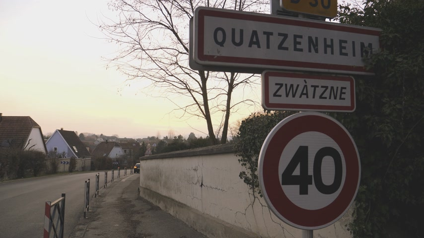 headstone : QUATZENHEIM, FRANCE - FEB 20, 2019: Welcome to Quatzenheim, Bas-Rhin, France sign Zwatzne is the Roman name Jewish cemetery in Quatzenheim near Strasbourg