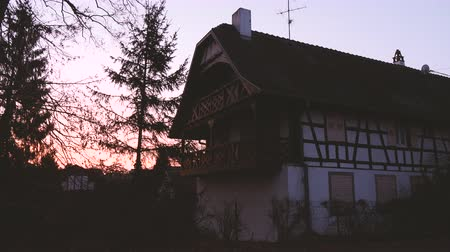 alsatian : Quatzenheim Alsace France with sunset over traditional Alsatian timbered house a few steps from old Jewish cemetery