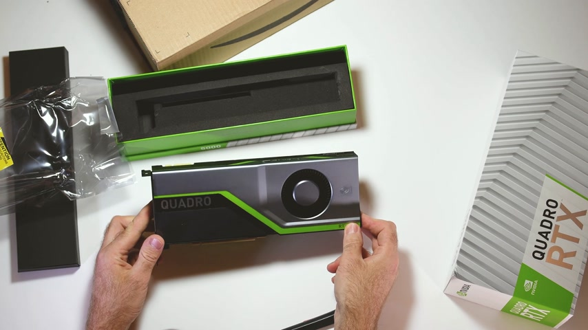 adaptador : Paris, France - Feb 20, 2019: Man admiring the latest Nvidia Quadro RTX 5000 workstation professional video card GPU adapter unboxing