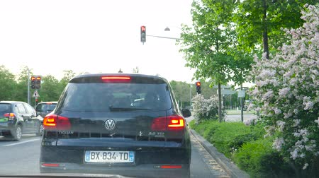 kompakt : Strasbourg, France - Circa 2019: Driver POV at the front driving car Volkswagen Tiguan 2.0 TDI SUV waiting at the intersection of Place Bordeaux in Strasbourg Stok Video