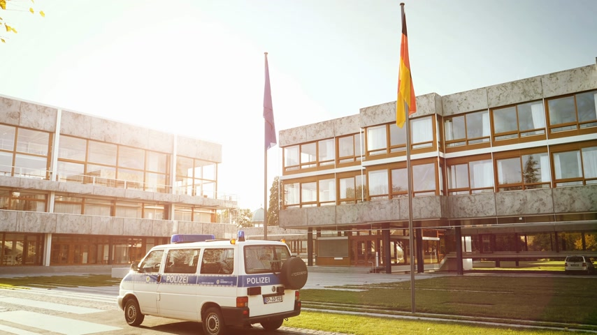volkswagen : Karlsruhe, Germany - Oct 29, 2017: Volkswagen police polizei van surveillance Federal Constitutional Court building Bundesverfassungsgericht with Eu and German flag waving cinematic sunligh flare