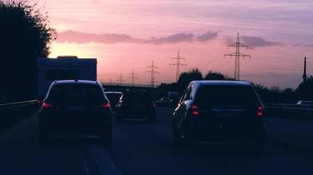 esquerda : Dortmund, Germany - Circa 2019: Driver POV personal perspective at the traffic jam on German autobahn at sunset with lots of cars motion driving slowly to destination driving on the left