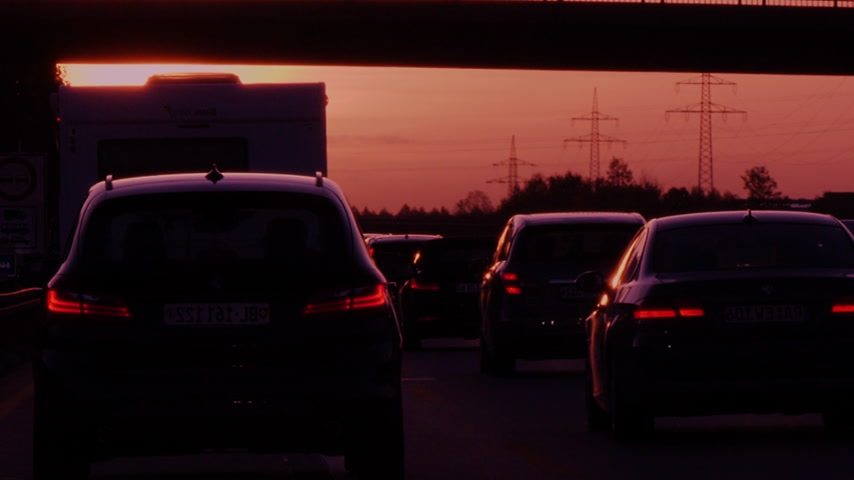 autobahn : Dortmund, Germany - Circa 2019: Cinematic color grading driver POV personal perspective at the traffic jam on German autobahn at sunset with lots of cars