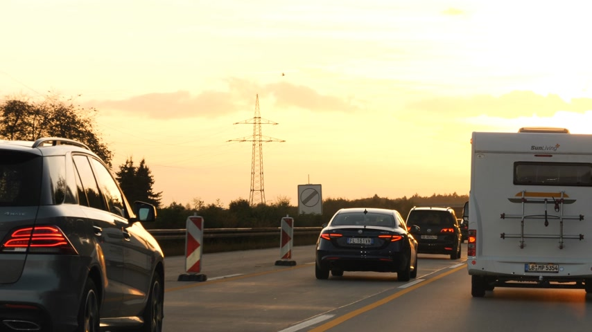 alfa : Dortmund, Germany - Circa 2019: Driver POV personal perspective at the traffic on German autobahn at sunset cars, vans, rv vehicles Stock Footage