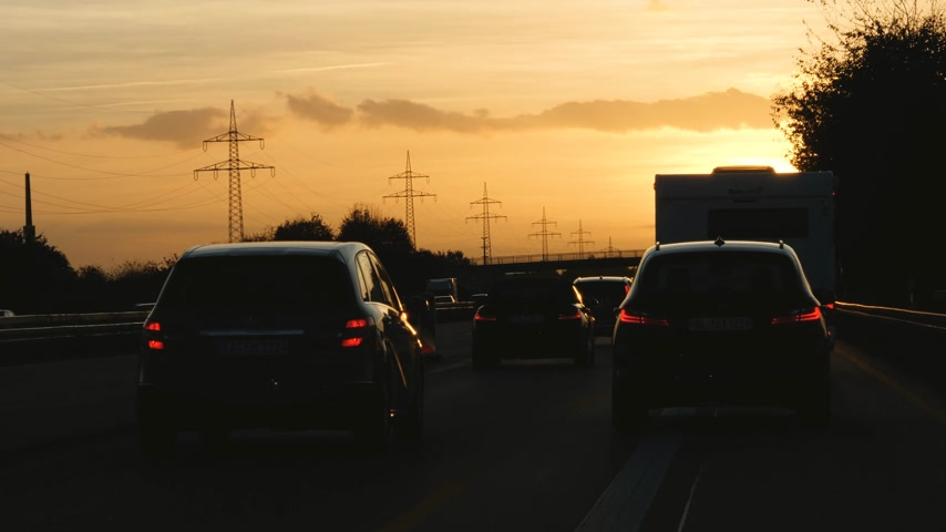 autobahn : Dortmund, Germany - Circa 2019: Cinematic Driver POV personal perspective at the traffic jam on German autobahn at sunset with lots of cars motion driving slowly to destination