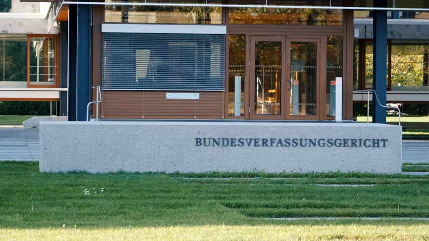 eljárás : Karlsruhe, Germany - Oct 29, 2017: Zoom out from Federal Constitutional Court Bundesverfassungsgericht the supreme constitutional court of Germany sign at entrance
