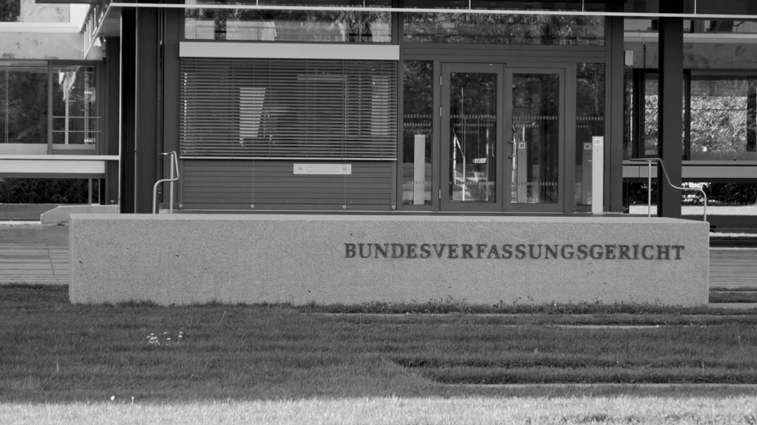 eljárás : Karlsruhe, Germany - Oct 29, 2017: Zoom out from Federal Constitutional Court Bundesverfassungsgericht the supreme constitutional court of Germany sign at entrance - black and white Stock mozgókép