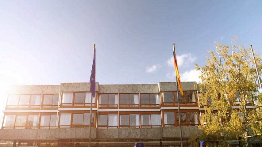 supremo : Sunlight flare over European union and Germany flag waving in front of Federal Constitutional Court building Bundesverfassungsgericht