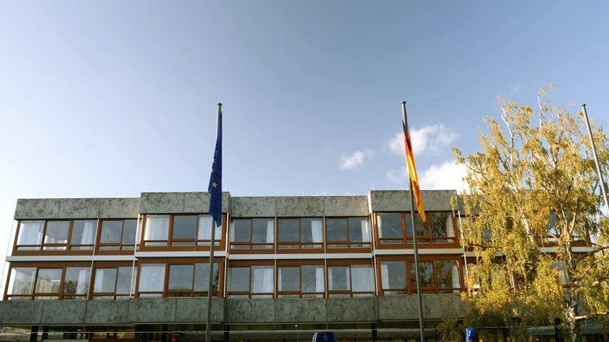 supremo : European union and Germany flag waving in front of Federal Constitutional Court building Bundesverfassungsgericht