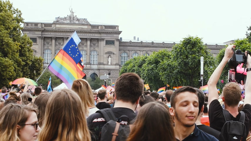 lesbijki : STRASBOURG, FRANCE - CIRCA 2018: People waving rainbow LGBT, EU and NATO flags at annual FestiGays pride parade marching in front University dancing fun party atmosphere Wideo