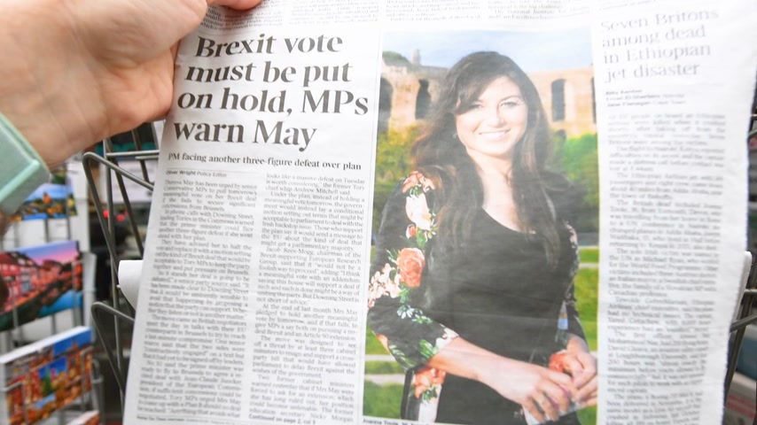 newspaper cover : Paris, France - Mar 12, 2019: British newspaper The Times featuring on the cover text that Brexit must be put on hold MP warn Theresa May