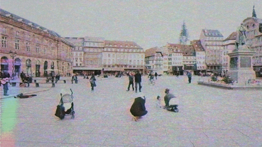 reporting : Strasbourg, France - Mar 12, 2019: VHS vintage tape film of wide image of central Place Kleber in Strasbourg on a sunny afternoon with peaceful people drawing with chalk flowers near General Kleber statue