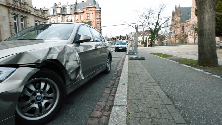 kompakt : Strasbourg, France - Mar 12, 2019: Panning to luxury BMW German car parked on city street with damaged front by accident on the road
