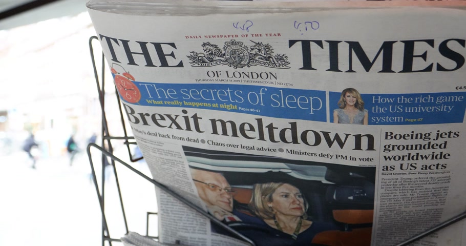 newspaper cover : Paris, France - Mar 15, 2019: Brexit meltdown tile on the times newspaper as British MPs have voted for a delay in the Brexit process for three months or more
