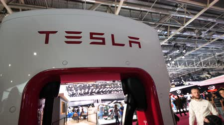 tesla car : PARIS, FRANCE - OCT 4, 2018: Tesla supercharger station for quick 480-volt fast-charging charging of Tesla cars at car motor expo exhibition show