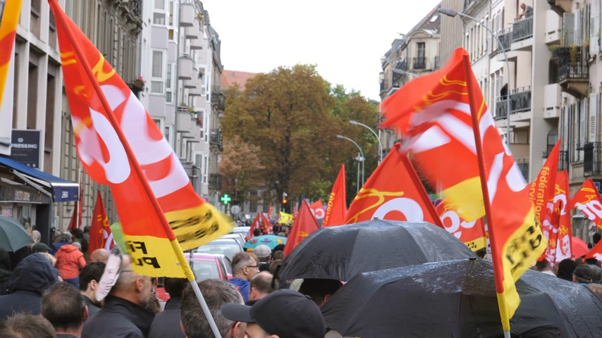 nationwide protest : Strasbourg, France - Sep 12, 2017: Tens of red CGT flags waving at political march during a French Nationwide day of protest against the labor reform proposed by Emmanuel Macron Government