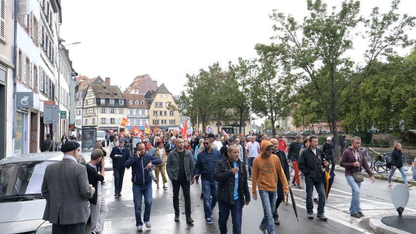 nationwide protest : Strasbourg, France - Sep 12, 2017: Young and adult people at political march during on Quai des Bateliers during French Nationwide day of protest against the labor reform proposed by Emmanuel Macron Government