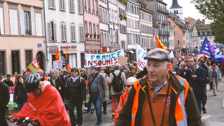 nationwide protest : Strasbourg, France - Sep 12, 2017: Young and adult people at large political march during a French Nationwide day of protest against the labor reform - blocking closing street thousands of people