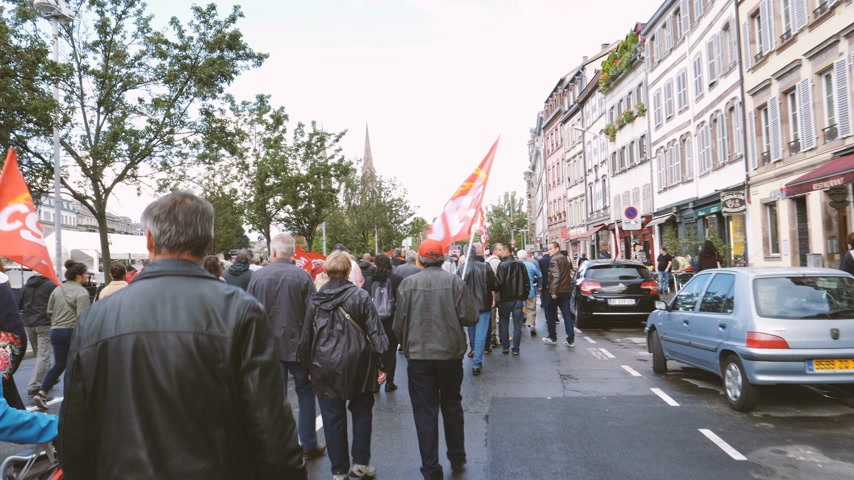 nationwide protest : Strasbourg, France - Sep 12, 2017: POV walking with protesters at political march during a French Nationwide day of protest against the labor reform proposed by Emmanuel Macron Government