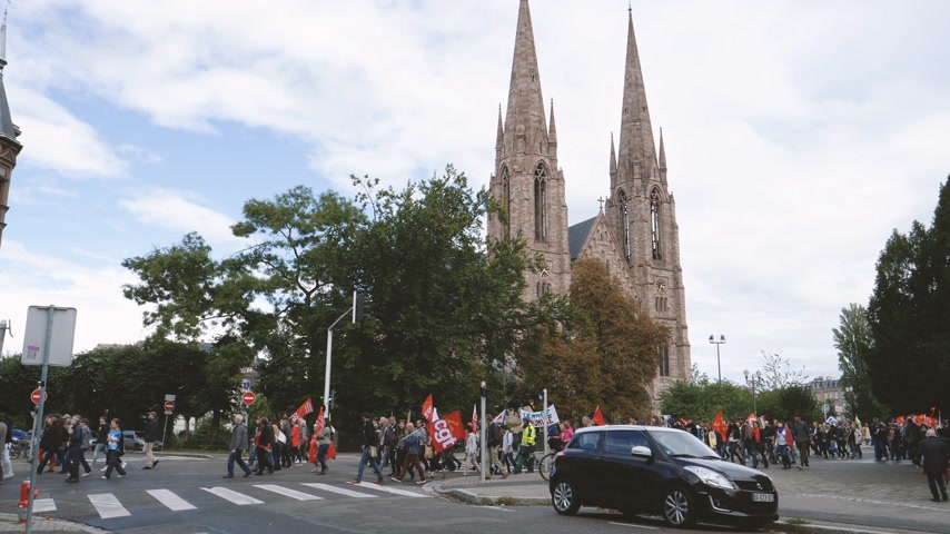 nationwide protest : Strasbourg, France - Sep 12, 2017: people march during a French Nationwide day of protest against the labor reforms with Eglise reformee Saint-Paul church in background