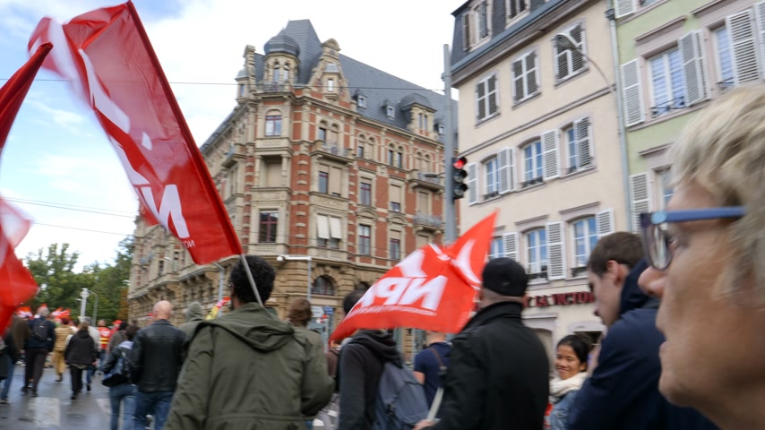 nationwide protest : Strasbourg, France - Sep 12, 2017: NPA New Anticapitalist Party nouveau parti anticapitaliste maintenant flags people at political march during a French Nationwide day of protest against labor reforms Stock Footage