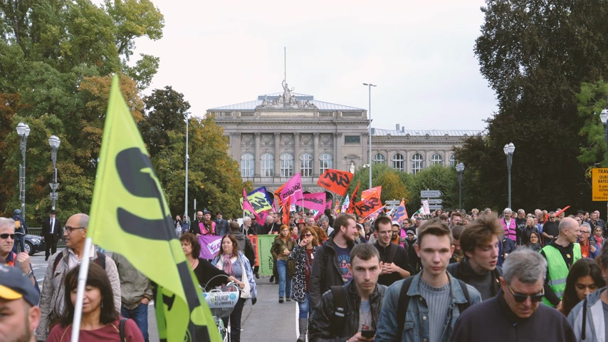 nationwide protest : Strasbourg, France - Sep 12, 2017: Young and adult people at political march during a French Nationwide day of protest against the labor reform with Strasbourg University building in background Stock Footage