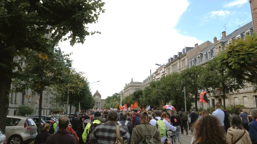 nationwide protest : Strasbourg, France - Sep 12, 2017: POV following Young and adult people at political march during a French Nationwide day of protest against the labor reform proposed by Emmanuel Macron Government