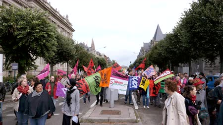 szakszervezet : Strasbourg, France - Sep 12, 2017: Group of people with placards at political march during a French Nationwide day of protest against the labor reform proposed by Emmanuel Macron Government